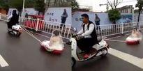 Rước dâu bằng xe lắc trẻ em, cô dâu chú rể 'sáng' nhất phố