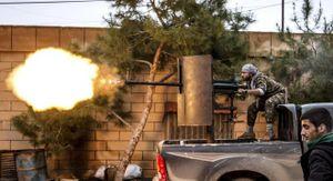 24h qua ảnh: Chiến binh Syria xả súng phòng không diệt IS