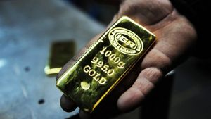 Đồng USD mạnh lên, gây sức ép với thị trường vàng thế giới