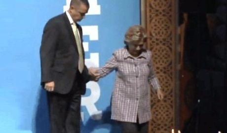 Ba Clinton ghi chat tay mat vu de tranh nga cau thang - Anh 1