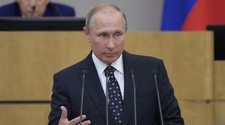 Tong thong Nga Putin keu goi tang cuong nang luc quoc phong - Anh 1
