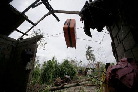 Bao manh khung khiep tan cong, gan 300 nguoi chet o Haiti - Anh 6