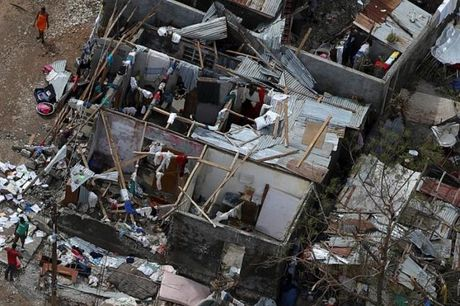 Bao manh khung khiep tan cong, gan 300 nguoi chet o Haiti - Anh 7