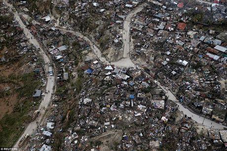 Nhung hinh anh tang thuong o Haiti sau khi sieu bao quet qua khien hon 300 nguoi chet - Anh 2