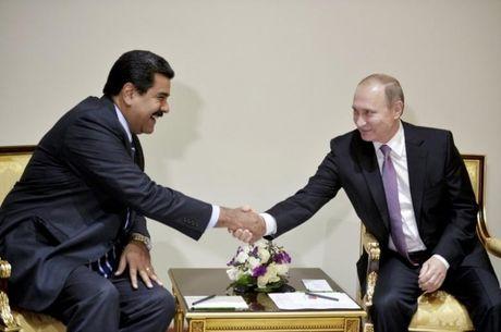 Venezuela lap giai hoa binh Hugo Chavez trao cho ong Putin cung ngay trao Nobel Hoa binh - Anh 1