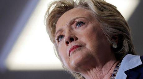 """Chung khoan Wall Street giam diem vi sao """"qua ta"""" chieu vao ung vien Hillary Clinton - Anh 1"""