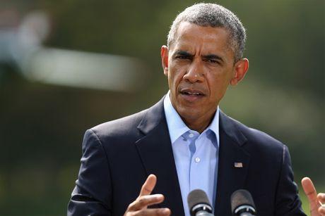 Tong thong Obama: Donald Trump la ke nang minh len bang cach dim nguoi khac xuong - Anh 1
