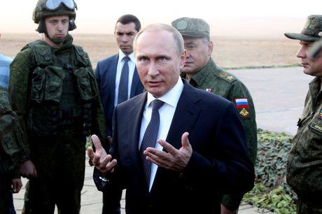 Tong thong Putin bat ngo ra lenh quan chuc goi nguoi than ve nuoc ? - Anh 2