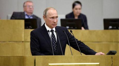 Tong thong Putin bac bo cao buoc Nga pha hoai bau cu My - Anh 1