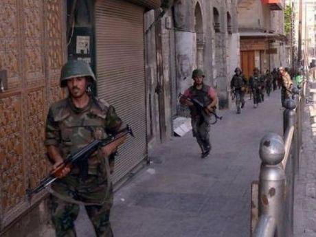 Quan doi Syria dang giam sat lenh ngung ban va rut khoi Aleppo - Anh 1